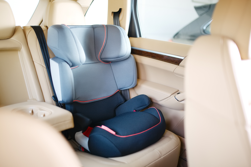 Image of a correctly fitted baby car seat