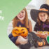 Two girls and one boy sat down laughing together whilst in their Halloween costumes