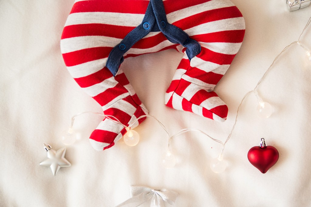 Christmas babies feet with baubles