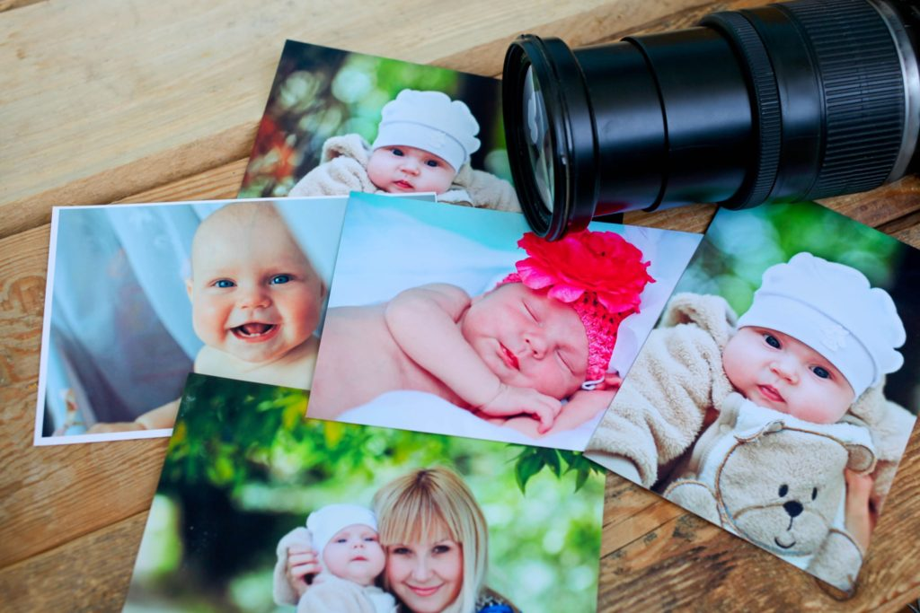 a collection of baby photos and a camera