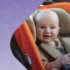 Baby smiles in a pushchair