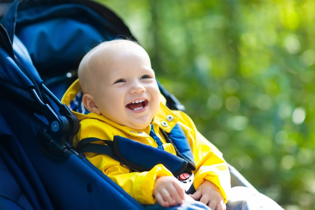 Baby laughing in coat