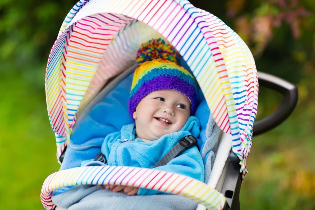 Baby wearing a hat, smiling