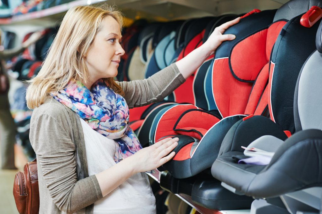 Pregnant woman, shopping for a car seat