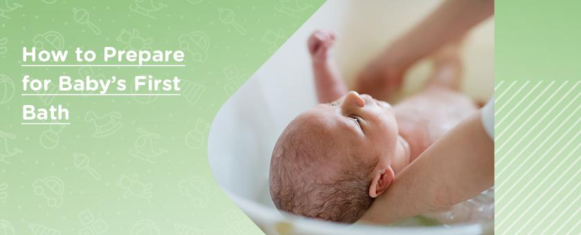 Newborn baby in baby bath whilst being held by parent