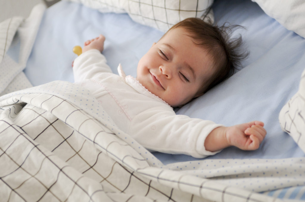 Baby smiling and happy whilst asleep