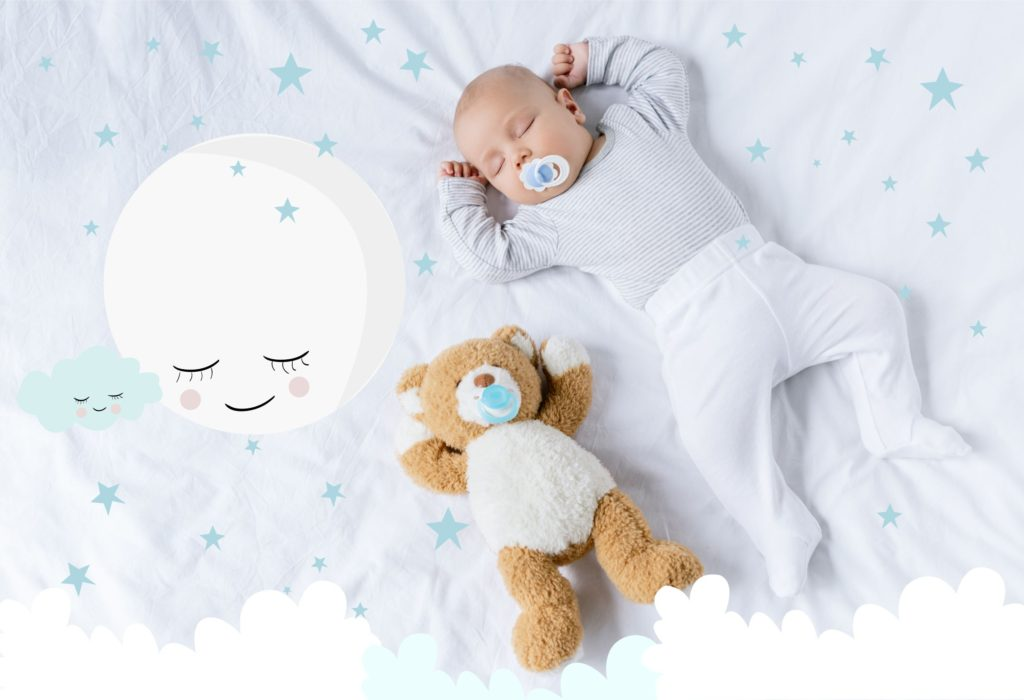 Newborn baby asleep with a dummy in their mouth whilst led on bedding with blue stars and a teddy next to them